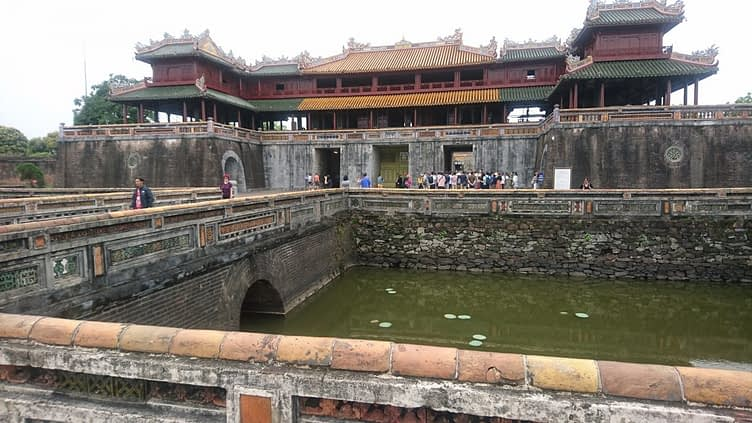 The Cua Ngo Mon, or 'Meridian' or 'South Gate', is the most prominent of the ten gates into the Imperial City. In the foreground you can see the moat which surrounds it