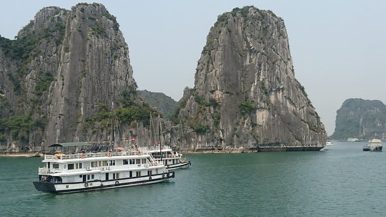 Halong Bay is large area of water on Vietnam's north east coast which is dotted with around 1,600 islands which poke out the water taller than they are wide