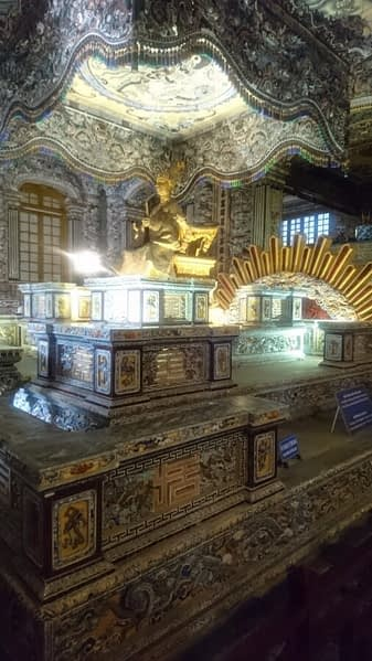 This spectacular tomb is topped with a gilt statue of Khai Dinh which was cast in Marseille