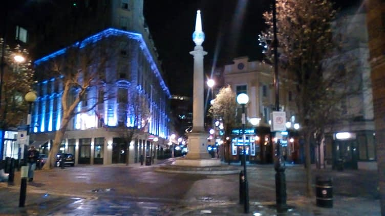 The Seven Dials, Covent Garden, devoid of cars and pedestrians at 8:00pm on a Sunday evening, 15 March 2020