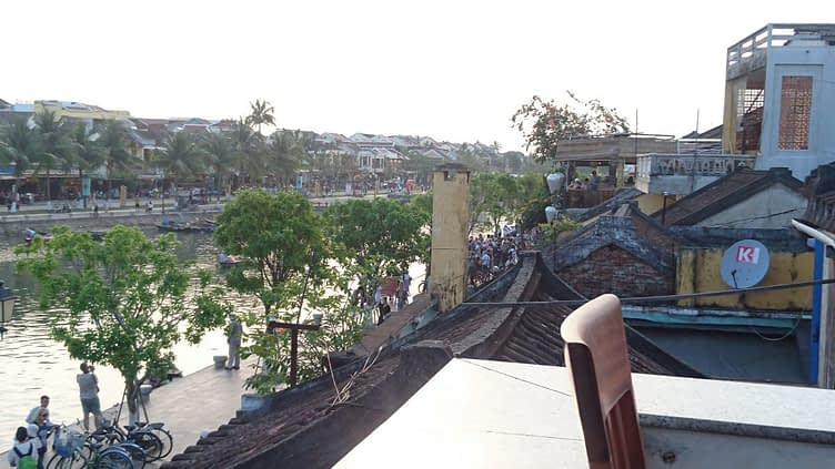 Dinner on a terrace overlooking the Thu Bon river