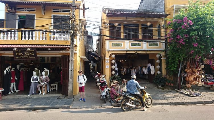 Like a visual metaphor for life in Vietnam, Hoi An is a chaotic mixture of tiny alleys, wide streets, tourist tat, fine craftsmanship, dirt and colour