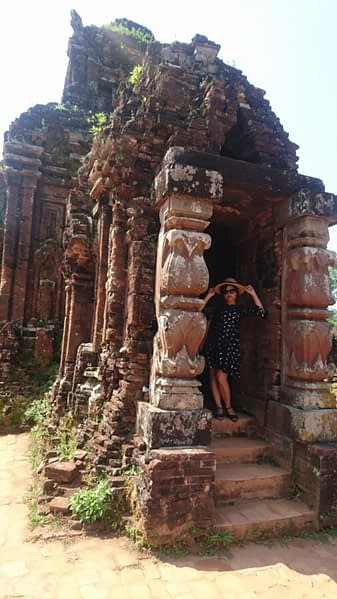 The temple buildings have thick walls and no windows, making them surprisingly cool. Not as cool as Ti, though, doing her best 'Audrey Hepburn'