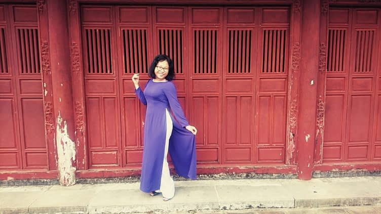 For my tour of Vietnam's ancient capital city, Hue, Ti donned her traditional, silk áo dài dress