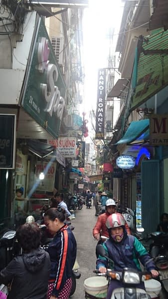 Old town Hanoi is a maze of narrow streets in which every inch is choked with street traders and scooters