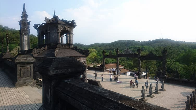 Looking down from the tomb, over the main gate to the jungle beyond, the tomb of Khai Dinh is splendid in its isolation