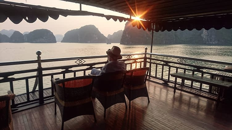 A large gin and tonic as I sit on the poop deck of the 'Rosa Boutique' and watch the sun set over Halong Bay