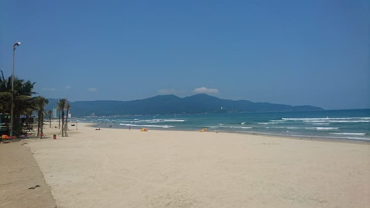 The view from My Khe beach looking north to the Son Tra peninsula with the huge, Lady Buddha statue just visible